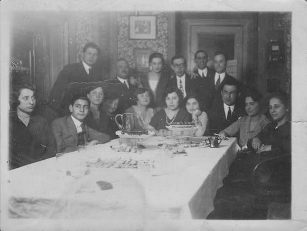 An extended family gathering at a big dining table